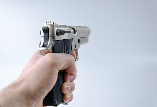 Hand holding a pistol.